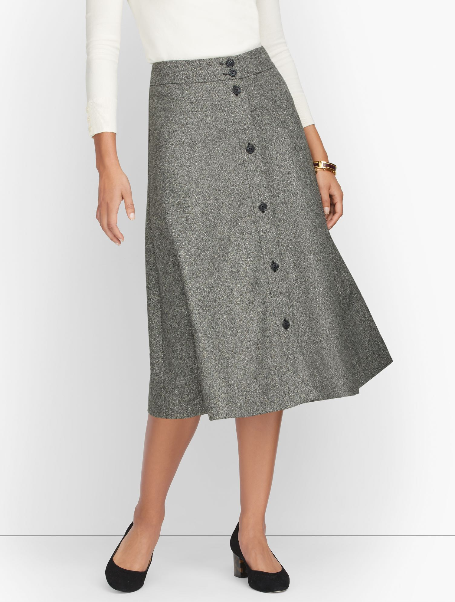 The button-front skirt. In a Donegal tweed. Renowned for multi-colored flecks that run through the weave. Twirl worthy. Features Silhouette: FullHits: Below KneeClosure: Button frontLinedImported Fit: Misses: 29 inches; Petite: 26 inches Material: 31% Viscose, 31% Polyester, 28% Wool, 10% Other Fibers; Lining 100% Polyester Care: Dry Clean Donegal Button Front Full Skirt - Black/White Donegal - 16 Talbots
