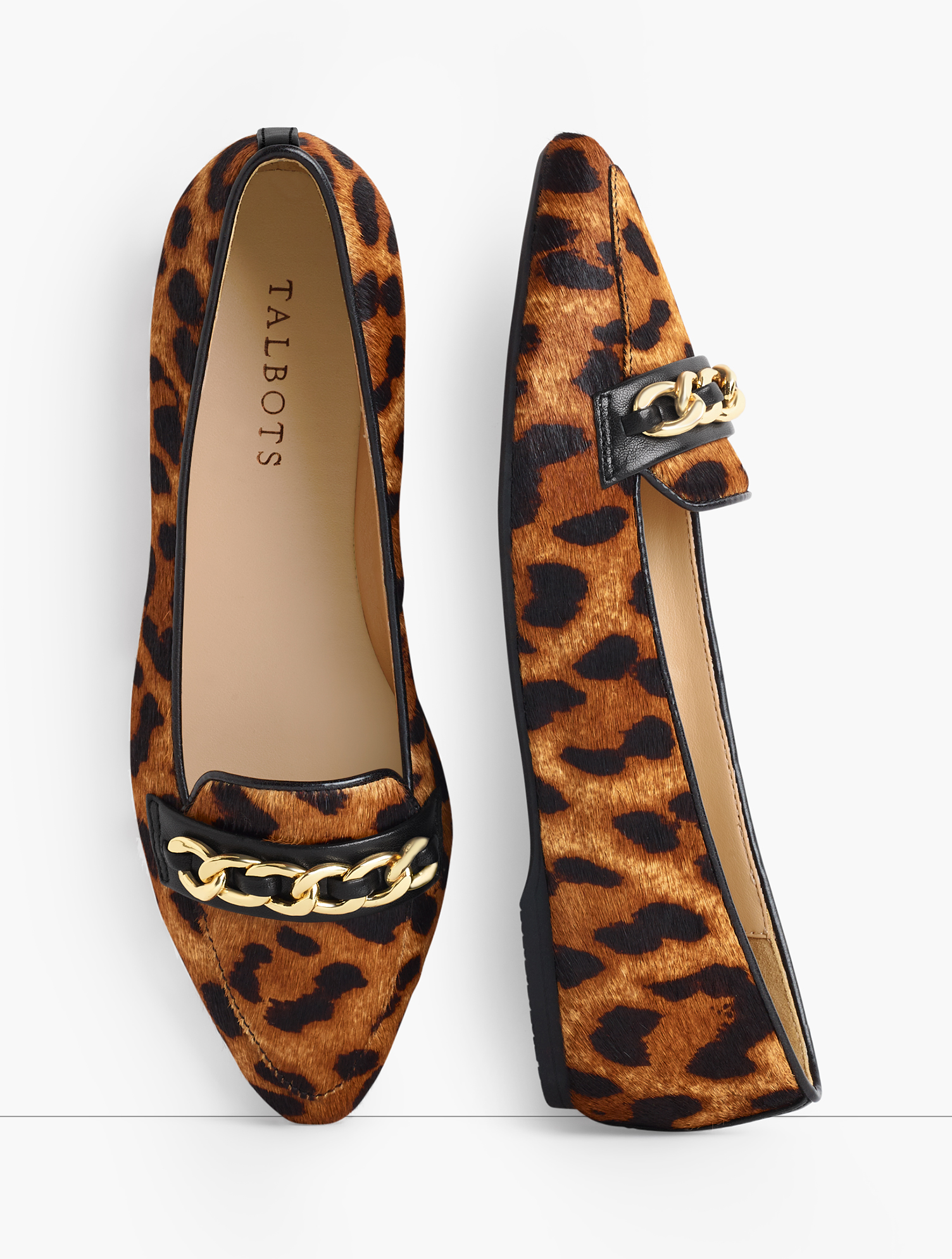 The Lucy. Classic loafers featuring a feminine pointed toe and elegant chain-link detail. In trending calf hair. Features Gift Box/Gift Wrap is not available for this item Gum sole Flat heel Pointed toe Chain Detail Imported Material: 100% Leather Lucy Chain Link Loafers - Calf Hair - Classic Leopard - 8-1/2M Talbots