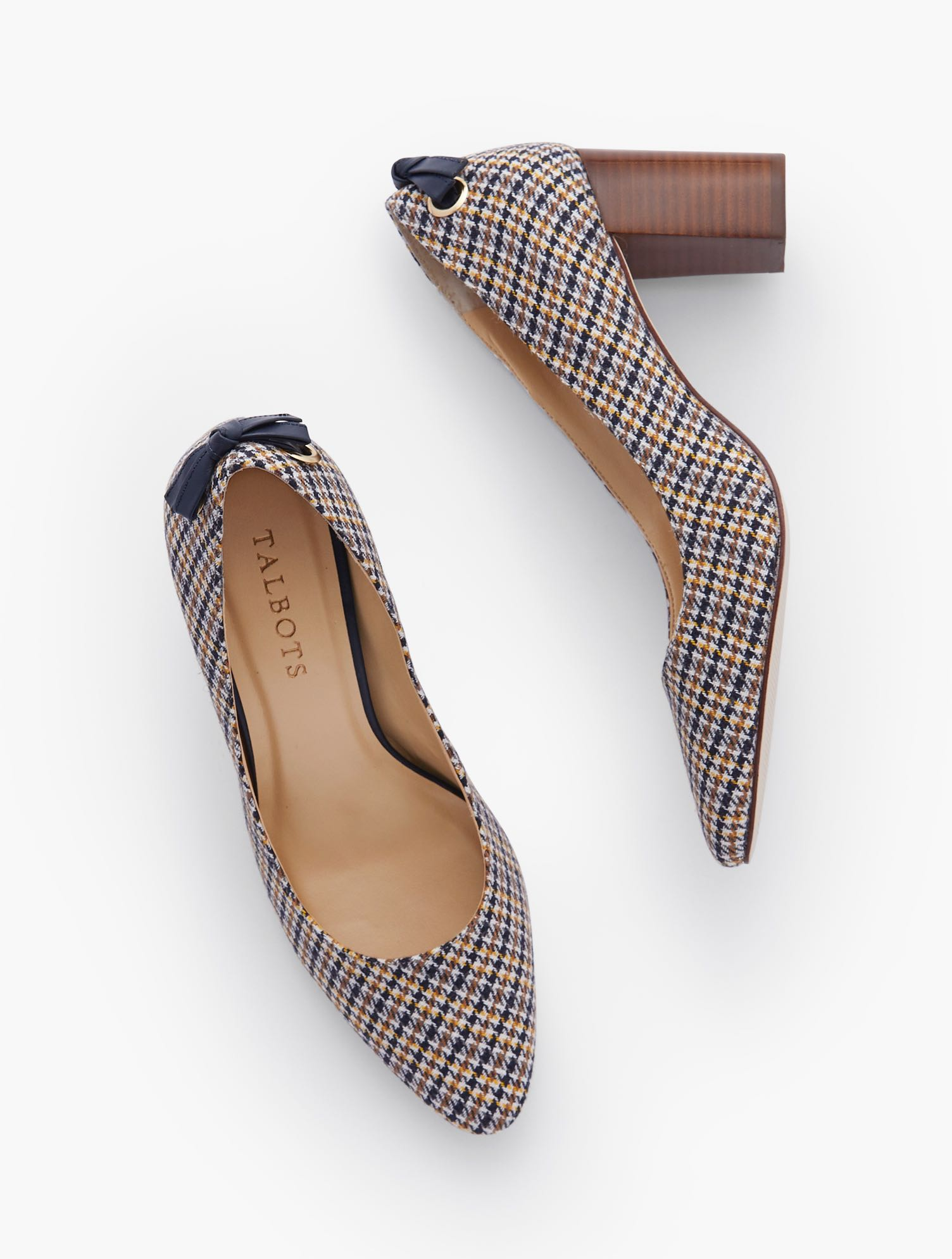 Our classic Kelsey Block Heel Pumps. Tie detail at back adds an extra dose of fashion interest. In elegant houndstooth. Features Gift Box/Gift Wrap is not available for this item 3MM Memory foam footbed 3 inches heel Back tie detail Almond toe Imported Material: 34% Acrylic, 33% Polyolefin, 19% Polyester, 10% Wool, 4% Other Fibers Kelsey Tie Detail Block Heel Pumps - Houndstooth - Ivory - 11M Talbots
