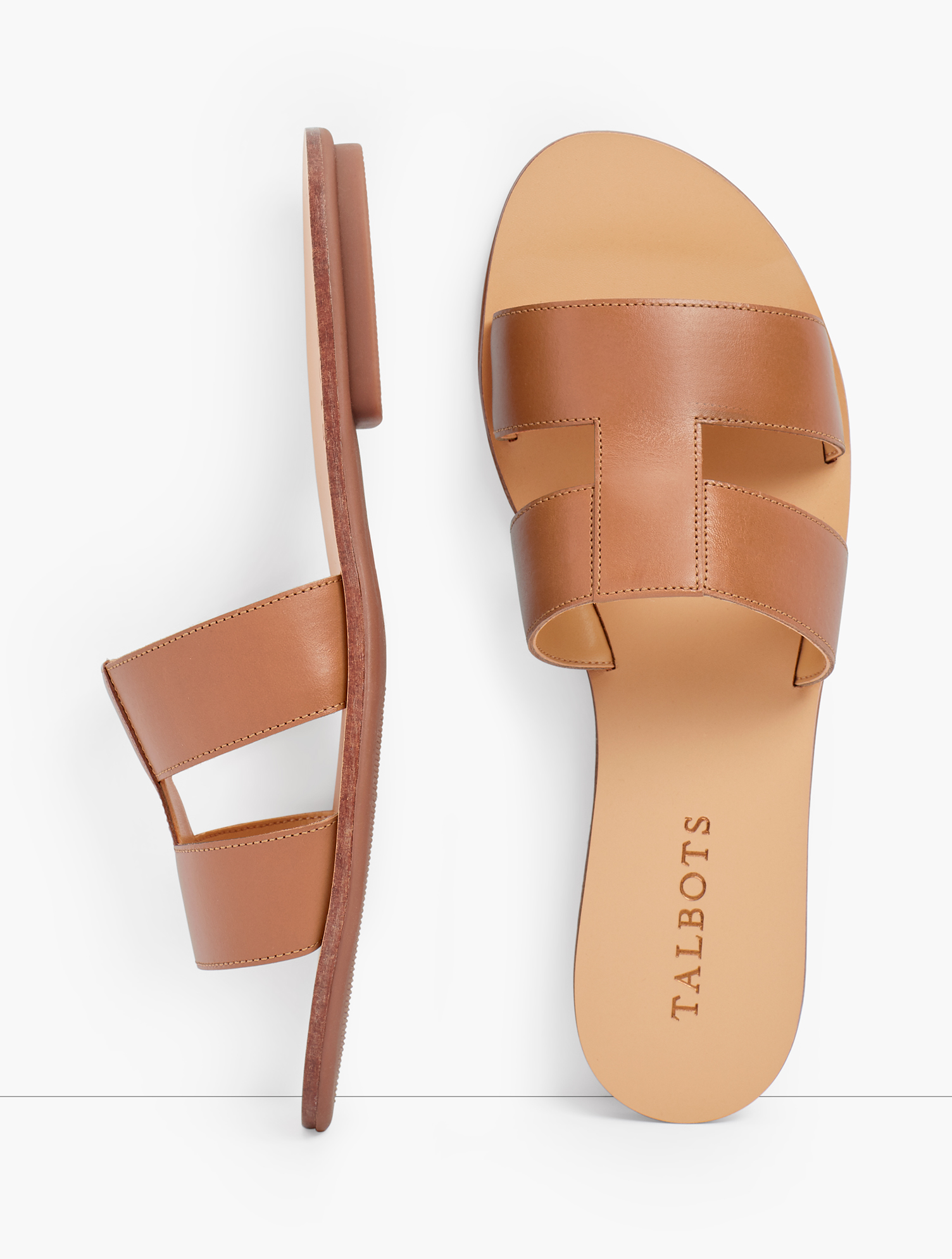 Luxe Vachetta leather slides. With geometric flair. A chic and easy go-to any day of the week. Features Gift Box/Gift Wrap is not available for this item 1/3 inches heel Rubber Sole Imported Material: 100% Leather Hannah Vachetta Leather Slides - Havana Tan - 11M Talbots
