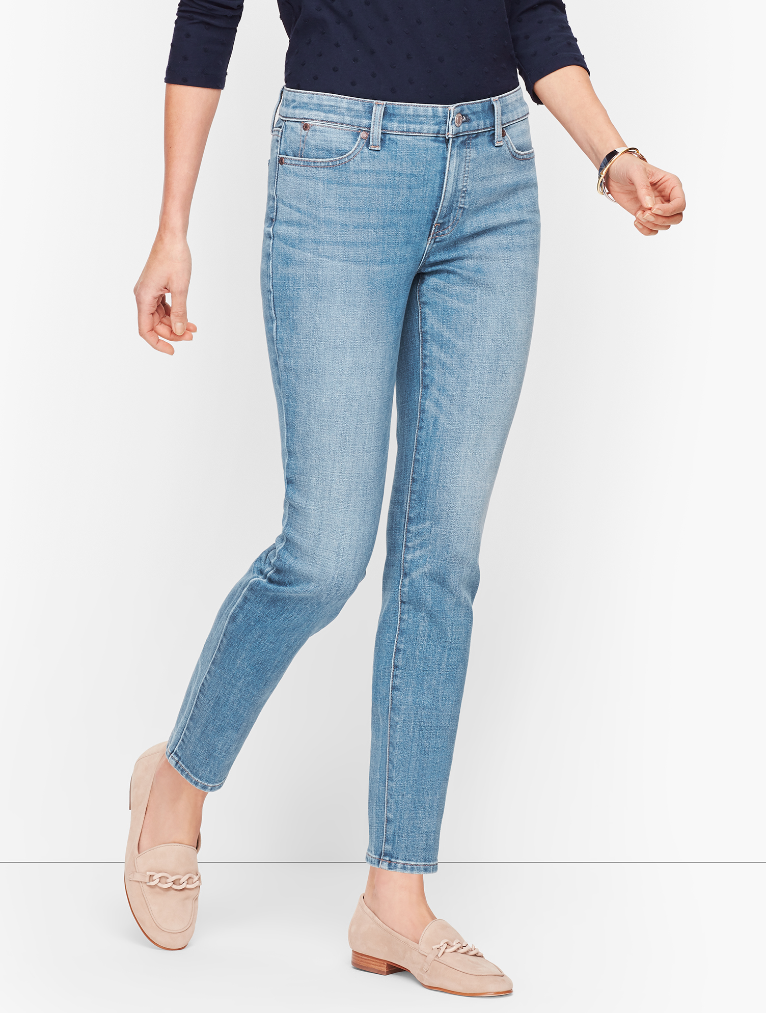 Our classic ankle-length jeans, featuring Flawless Five Pocket styling with our invisible slimming panel. Also offered in Slim Ankle Jeans - Curvy Fit - Wythe Wash. Features Slim leg Hits: At Waist Ankle length Closure: Fly front with button Pockets: Five Pocket Imported Fit: Inseam: Misses: 29 inches; Misses Long: 31 inches Petite: 26 1/2 inches inches Material: 70% Cotton, 29% Polyester, 1% Spandex Care: Machine Wash; Tumble Dry Slim Ankle Jeans - Wythe Wash - 16 Talbots