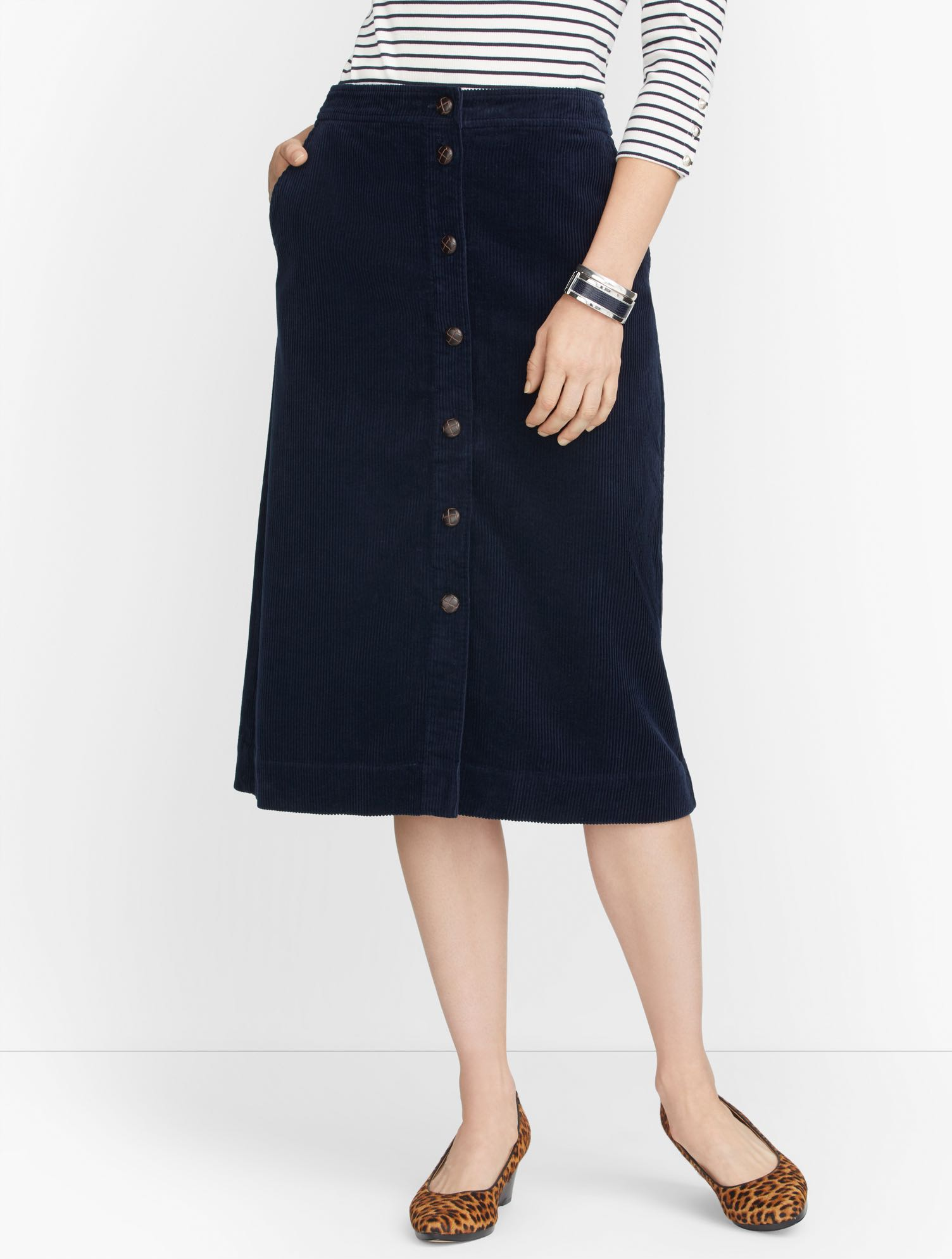 The corduroy button-front skirt. There\\\'s something about the plushness and warmth that just says fall. Features Silhouette: A-lineHits: Below KneeClosure: Button frontPockets: Front Slash & Back WeltImported Fit: Misses: 27 inches; Petite: 24 1/2 inches Material: 78% Cotton, 22% Lyocell Care: Machine Wash; Tumble Dry Corduroy Button Front Skirt - Blue - 16 Talbots