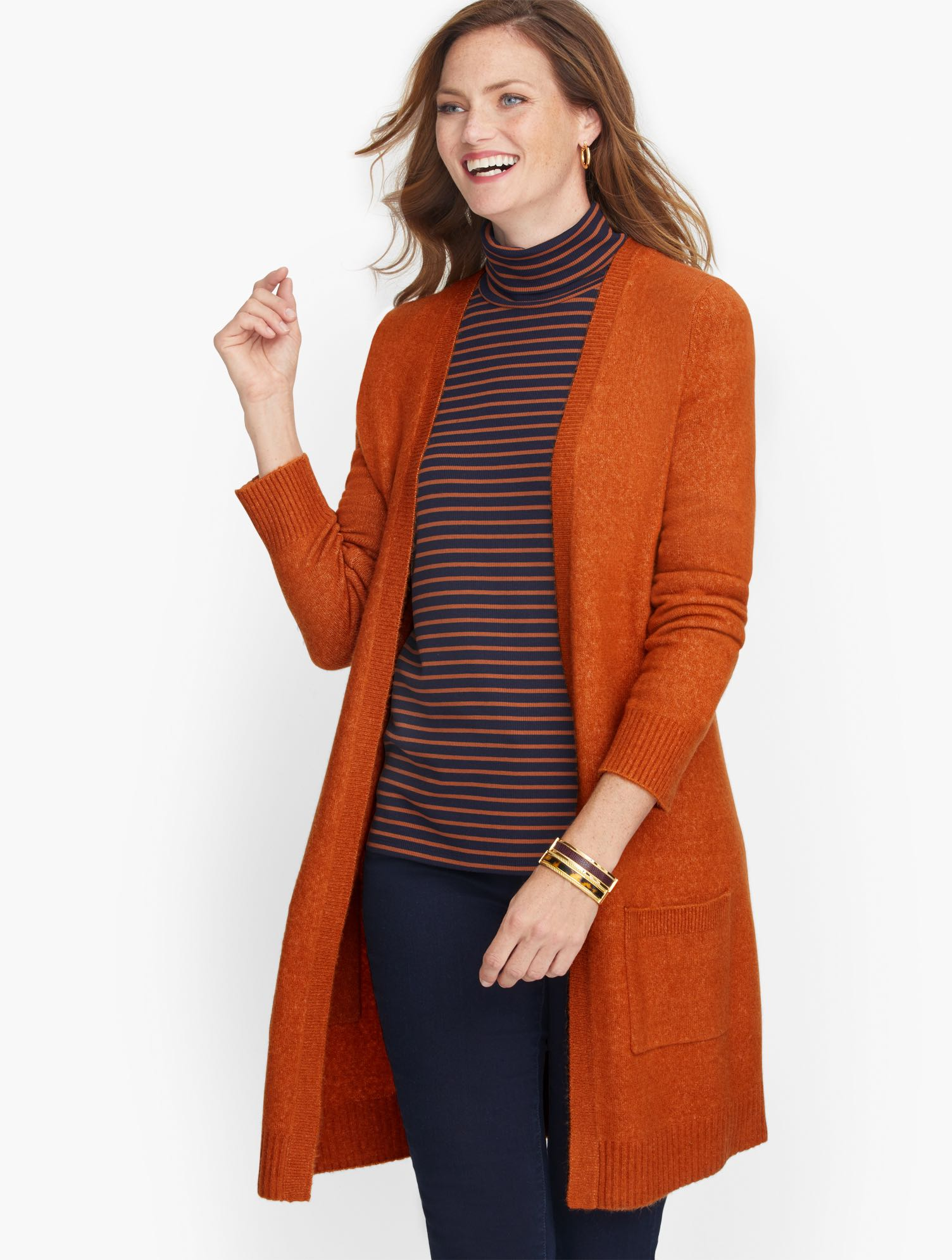 Our longer cardigan, AKA the third piece. With pockets where you want them. Light and airy, it\\\'s the perfect layer with jeans and a tee. Features Neckline: No Close Sleeve length: Long Hits: Below hip Closure: No Close Pockets: Patch Imported Fit: Misses: 33 inches; Petite: 30 1/2 inches, Plus: 33 1/2 inches Material: 44% Acrylic, 35% Nylon, 7% Wool, 7% Alpaca, 7% Spandex Care: Hand Wash; Reshape, lay flat to dry Flyaway Cardigan Sweater - Rich Spice - XL Talbots