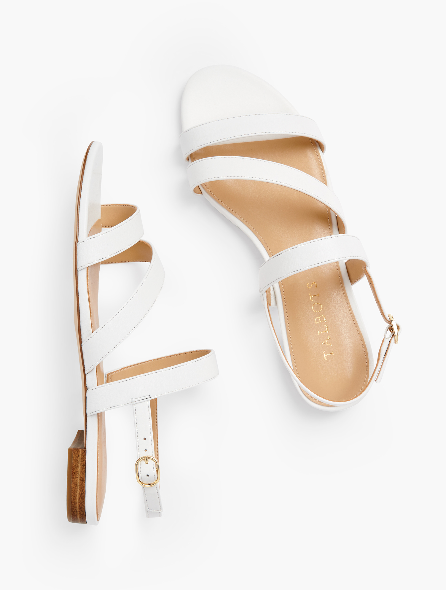 Easy elegance. Our Keri multi-strap sandals were made to be worn dressy or casual. Features Gift Box/Gift Wrap is not available for this item 1/2 inches heel Flexible Non Skid Outsole 9k Shiny Gold Hardware 3Mm Memory Foam Footbed Imported Material: 100% Leather Keri Multi Strap Sandals - Nappa - White - 9M Talbots