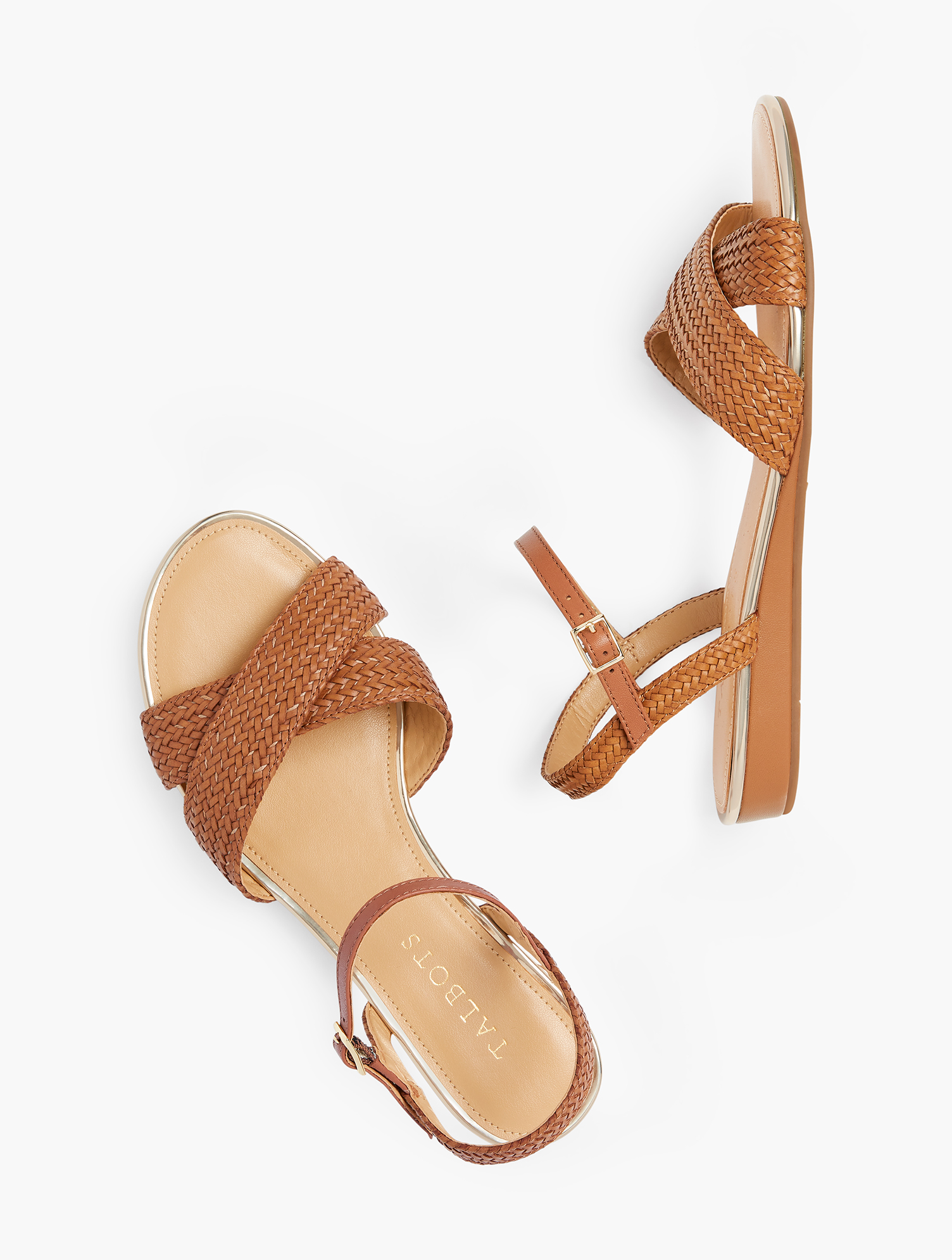 The Daisy. Our modern micro-wedge gives you just the lift you need. Classic and comfortable. Features Gift Box/Gift Wrap is not available for this item 3/4 inches Heel Round toe 3MM Memory foam footbed Imported Material: 100% Polyurethane Daisy Micro Wedge Sandals - Solid - Havana Tan - 11M Talbots