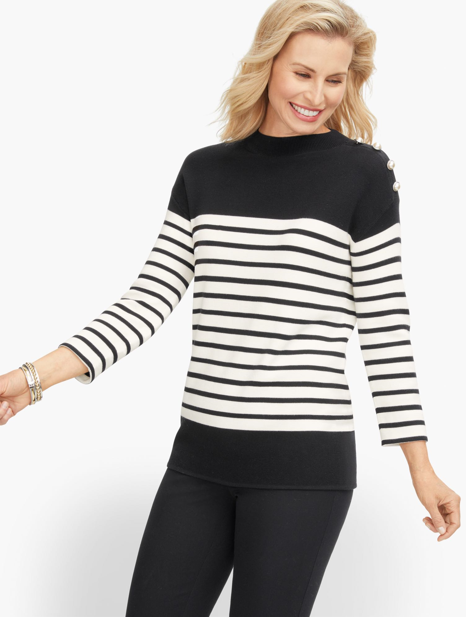 Our mockneck stripe sweater. In a refined cotton blend. The moment you feel it, you\\\'ll know how special it is. Buttons at shoulder add an extra dose of fashion interest. Features Sleeve length: Three-QuarterNeckline: MockHits: At hipClosure: PulloverImported Fit: Misses: 25 1/2 inches; Petite: 24 1/2 inches Material: 60% Cotton, 40% Viscose Care: Machine Wash; Reshape, lay flat to dry Mockneck Stripe Sweater - Black/Ivory - XL Talbots