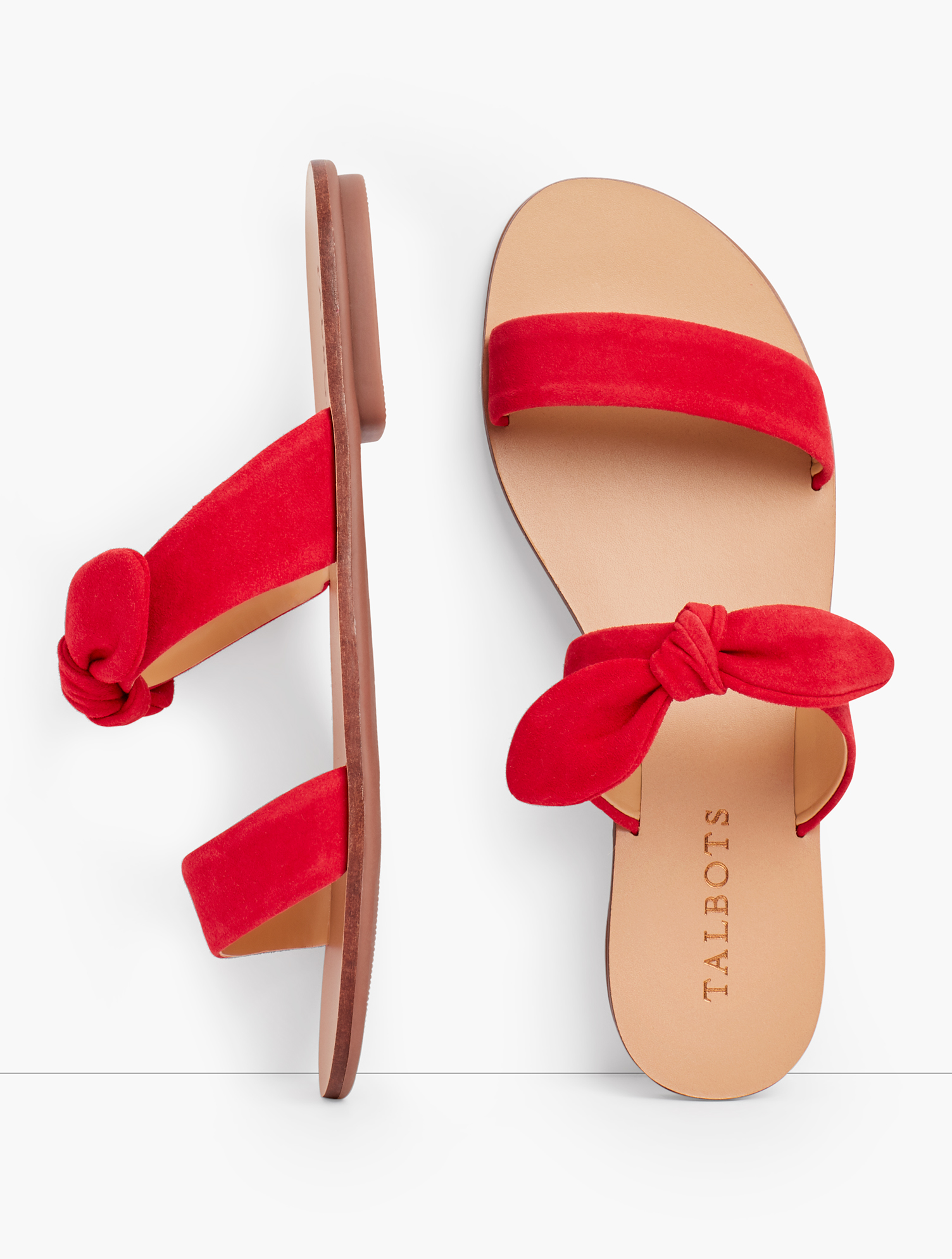 Hannah slides in soft suede. Fun knotted detail. Features Gift Box/Gift Wrap is not available for this item 1/3 inches heel Rubber Sole Imported Material: 100% Leather Hannah Knotted Slides - Suede - Red - 10M Talbots