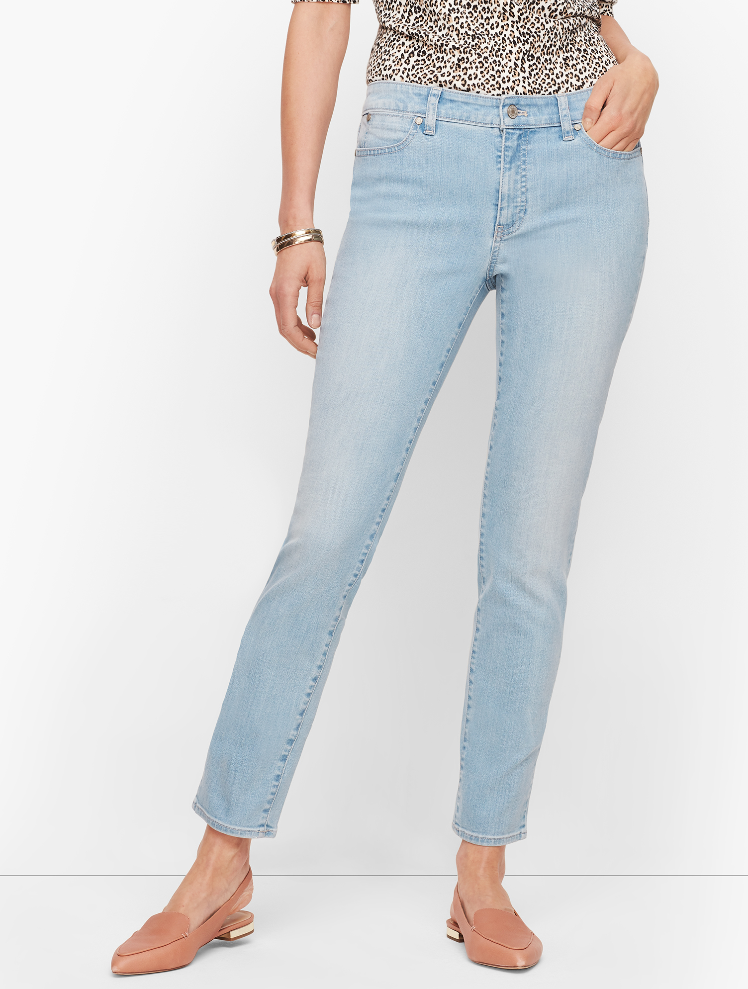 Our Slim Ankle Jean. A touch of stretch. Endless style and comfort. Forever flattering. Also available in Curvy Fit - Slim Ankle Jeans - Skillman Wash - Curvy Fit. Features Slim leg Hits: Above Waist Ankle length Closure: Fly front with button Front Pockets: Five Pocket Back Pockets: Five Pocket Imported Fit: Inseam: Misses: 29 inches; Misses Long: 31 inches; Petite: 26 1/2 inches; Material: 93% Cotton, 6% Polyester, 1% Spandex Care: Machine Wash; Tumble Dry Slim Ankle Jeans - Skillman Wash - 18