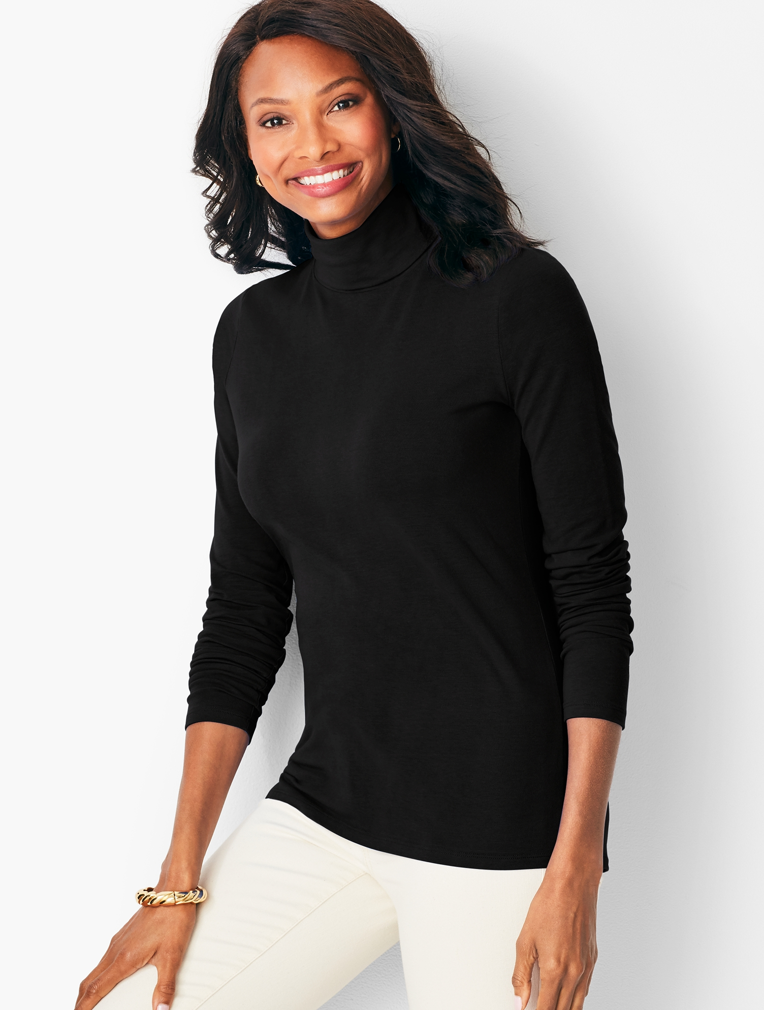 A tried and true cotton-spandex turtleneck in all-new must-have colors. Wear this solid wardrobe staple with any blazer or sweater over jeans or a skirt. features Classic turtleneck silhouetteLong sleevesImported Fit: Length: Misses 25 1/2 inches; Petite 24 1/2 inches; Plus Size 27 inches; Plus Size Petite 26 inches Material: 95% cotton/5% spandex Care: Machine wash; tumble dry Long-Sleeve Turtleneck - Black - XL Talbots