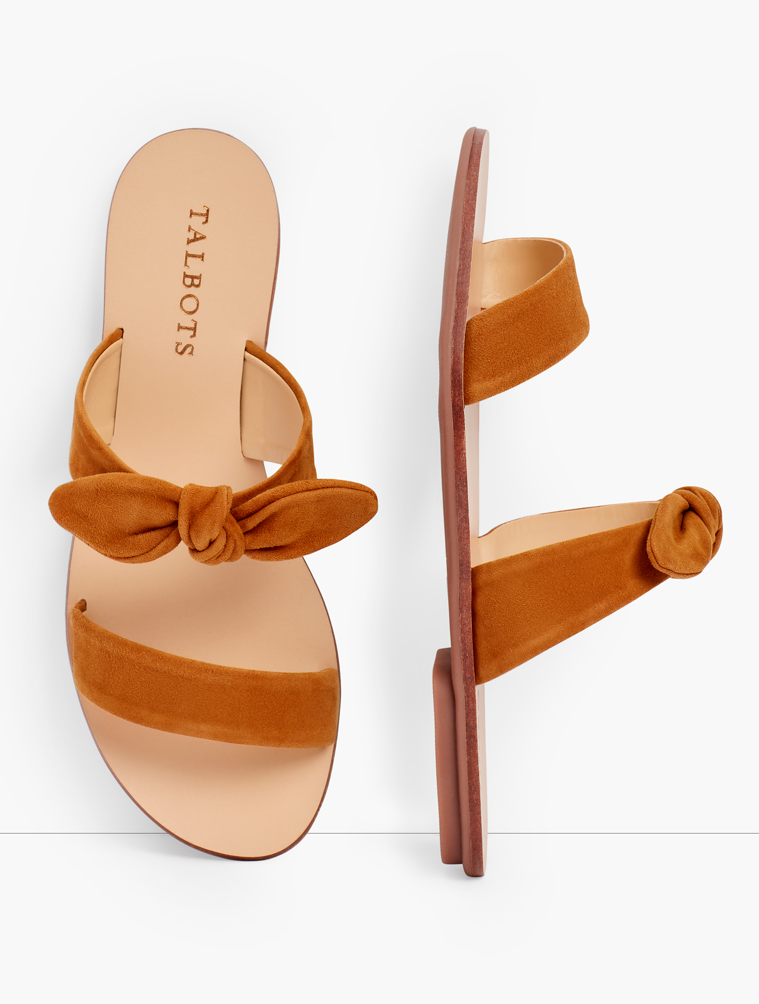 Hannah slides in soft suede. Fun knotted detail. Features Gift Box/Gift Wrap is not available for this item 1/3 inches heel Rubber Sole Imported Material: 100% Leather Hannah Knotted Slides - Suede - Spring Sienna - 7M Talbots