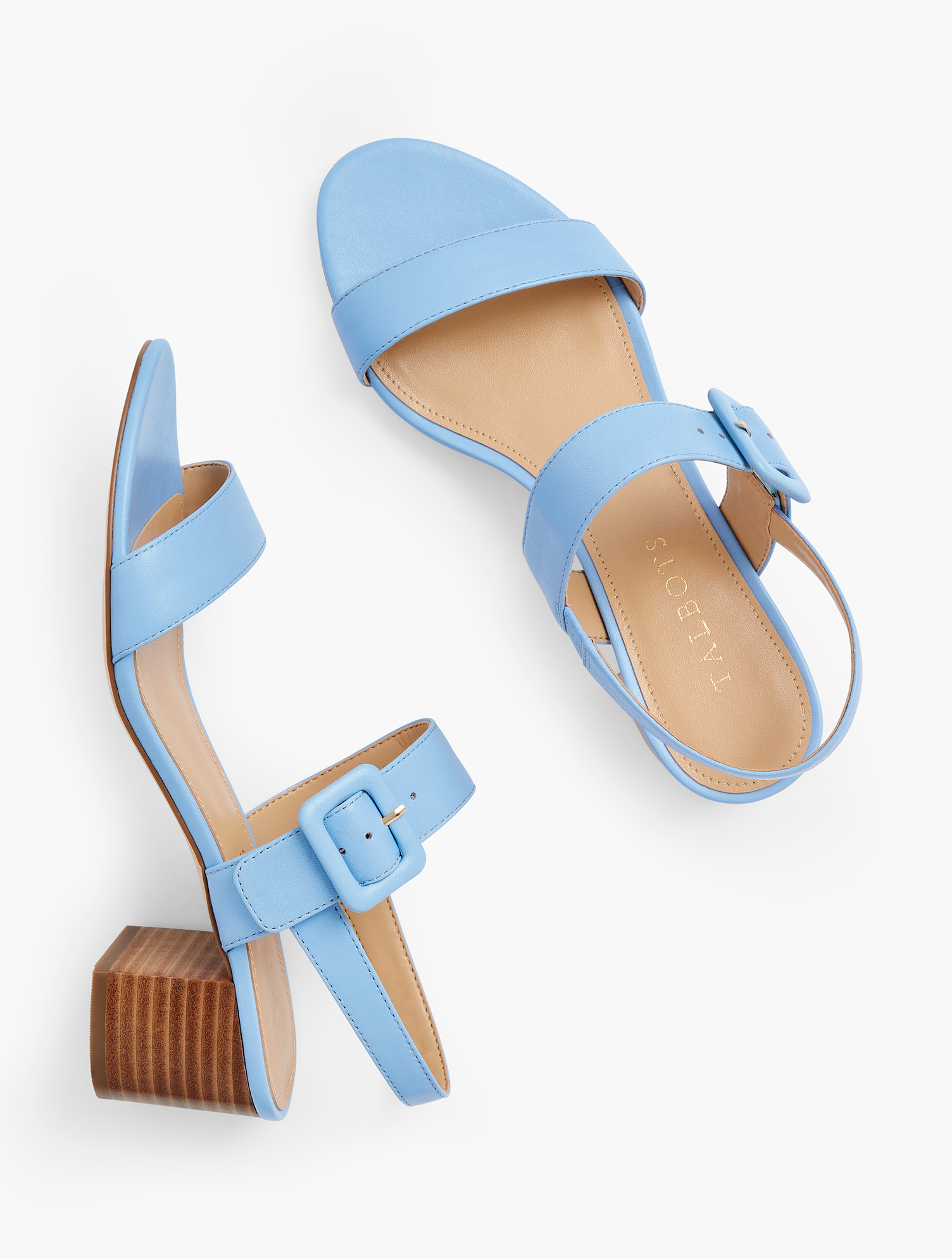 Our chic Mimi block-heel sandals. With fashionable, buckle closure. Crafted from soft Nappa leather for comfort and luxury. Features Gift Box/Gift Wrap is not available for this item 2 inches heel Flexible Non Skid Sole 3Mm Memory Foam Footbed Imported Material: 100% Leather Mimi Leather Block Heel Sandals - Laguna Blue - 7M Talbots