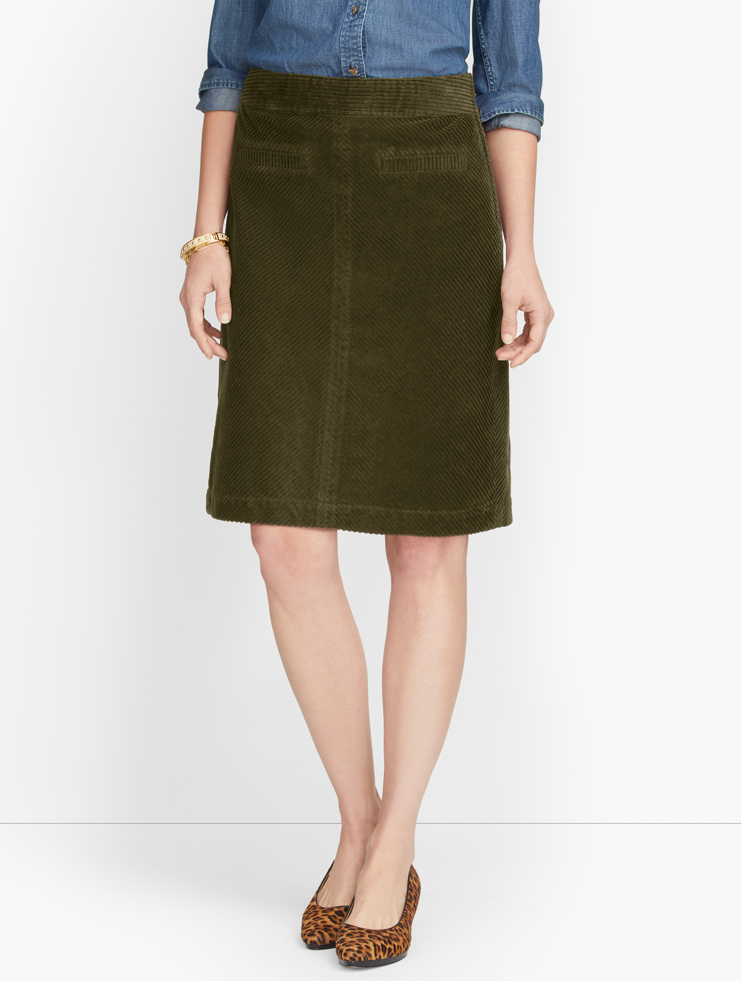 The classic A-line skirt. In lustrous wide wale corduroy. Plush. Warm. Incredibly versatile. The season\\\'s must-have. Features Silhouette: A-lineHits: Top of KneeClosure: Side zipPockets: Front WeltImported Fit: Misses: 20 1/2 inches; Petite: 19 1/2 inches Material: 100% Cotton Care: Machine Wash; Tumble Dry Wide Wale Corduroy Skirt - Olive Night - 16 - 100% Cotton Talbots