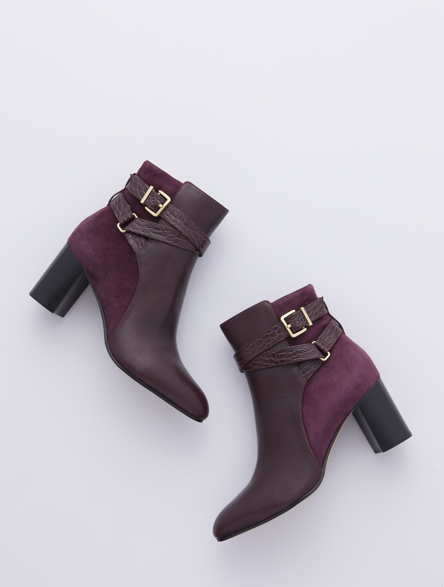 Versatile leather booties with a sleek silhouette, feminine flare heel and almond-shaped toe. Inside-step zip allows for easy on and off. Features Gift Box/Gift Wrap is not available for this item 3 inches heel Almond toe 3MM Memory foam footbed Side Zip Imported Material: 100% Leather Simone Vachetta Ankle Boots - Rich Burgundy - 11M Talbots