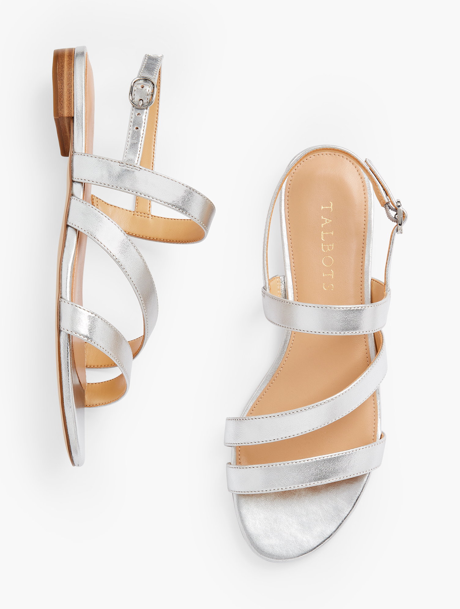Easy elegance. Our Keri multi-strap sandals were made to be worn dressy or casual. Features 1/2 inches heelFlexible Non Skid OutsoleShiny Nickle Hardware3Mm Memory Foam FootbedImported Material: 100% Leather Keri Multi Strap Sandals - Metallic - Silver - 9M Talbots