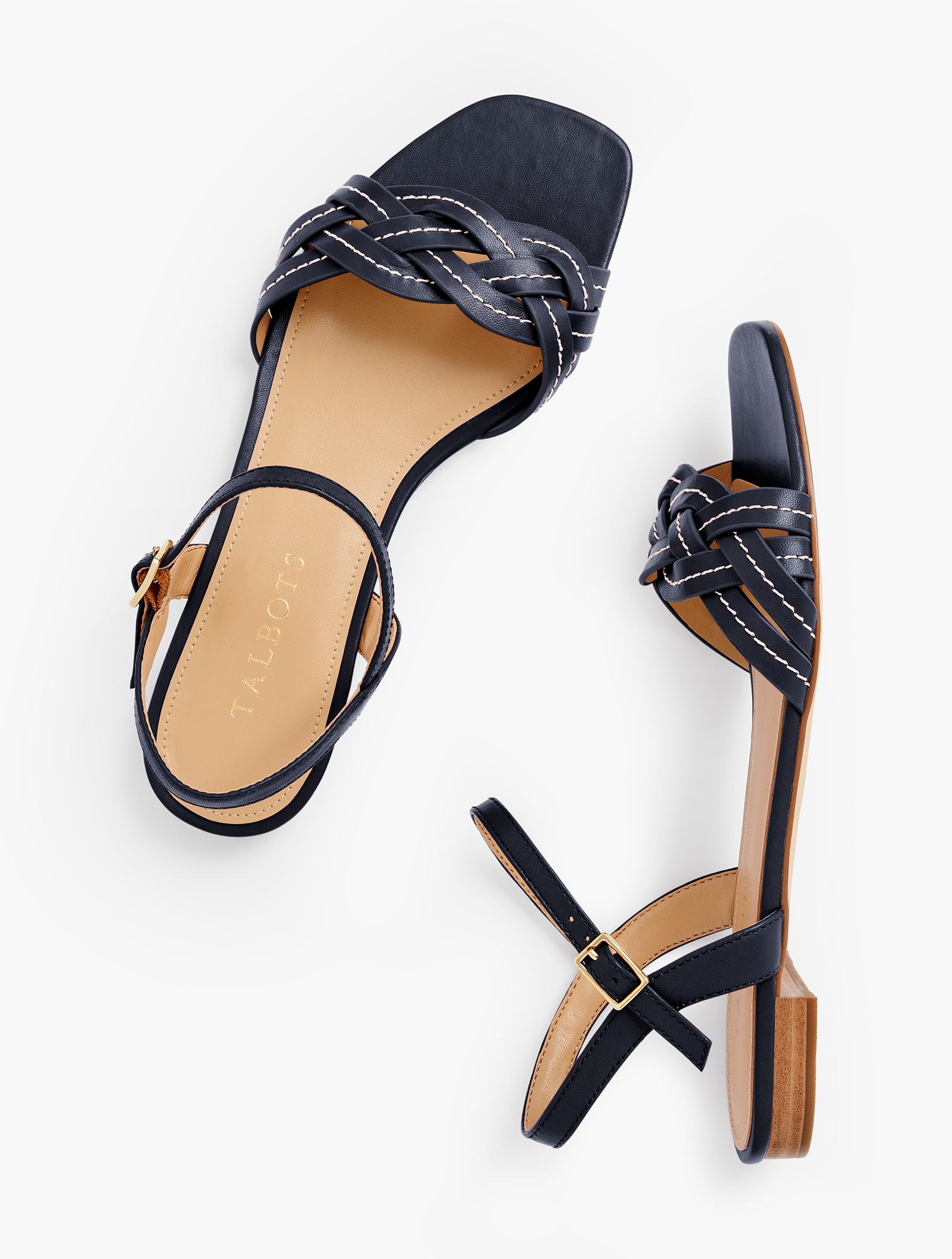 Our Violet braided sandals. Featuring an on-trend square footbed. In a variety of colors so you don\\\'t have to choose just one. Features 1/2 inches heelSquare ToeFlexible Non Skid Sole3Mm Memory Foam FootbedImported Material: 100% Leather Violet Braided Flat Sandals - Indigo - 7M Talbots