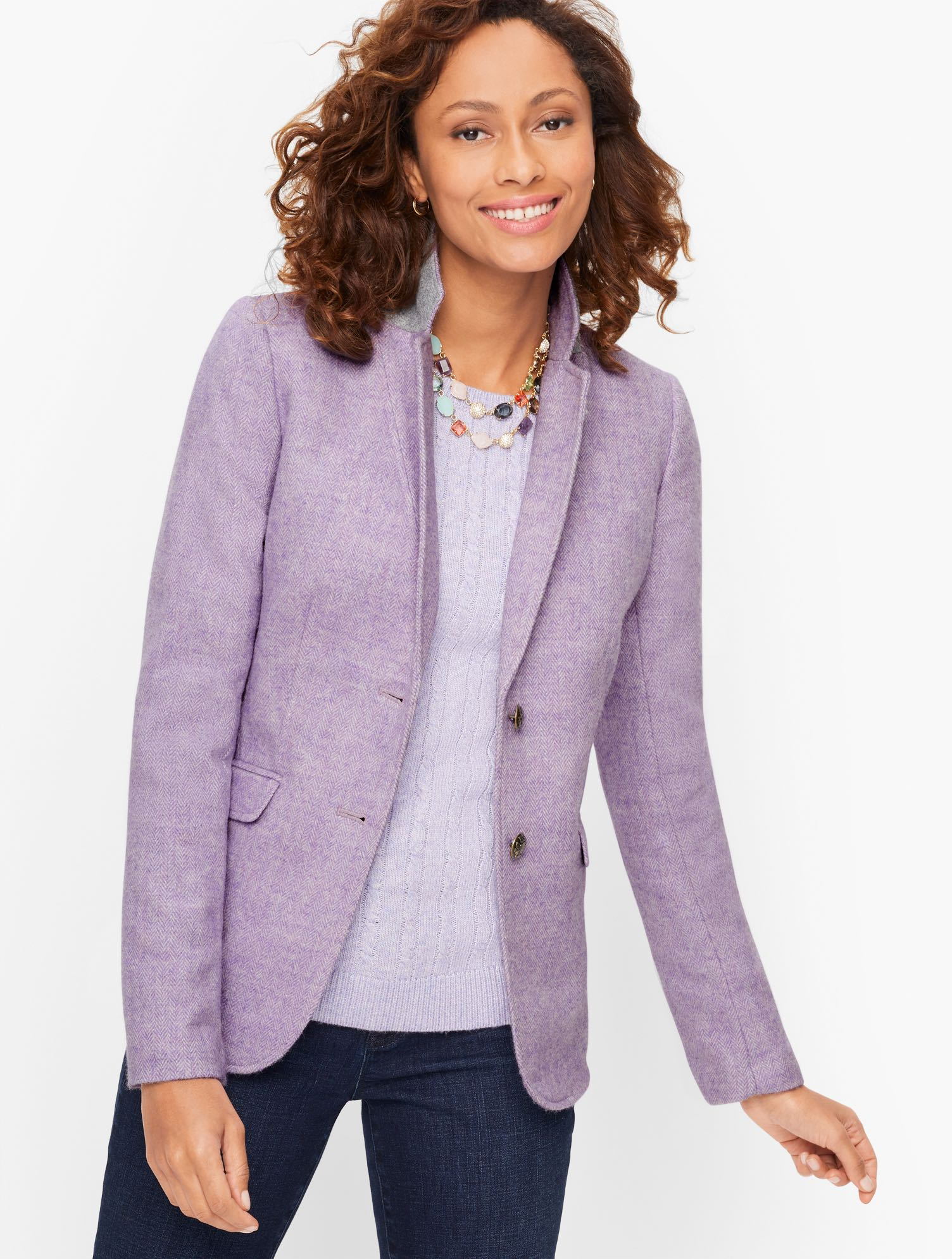 Our perennial Shetland Blazer, in mélange herringbone. A timeless style that always feels new. Features Sleeve length: LongHits: At hipClosure: Button FrontLinedImported Fit: Misses: 25 inches; Petite: 23 1/2 inches; Plus: 27 inches; Plus Petite: 25 1/2 inches Material: 48% Wool, 27% Polyester, 25% Viscose; Lining 100% Polyester Care: Dry Clean Classic Shetland Blazer - Mélange - Lilac - 22 Talbots