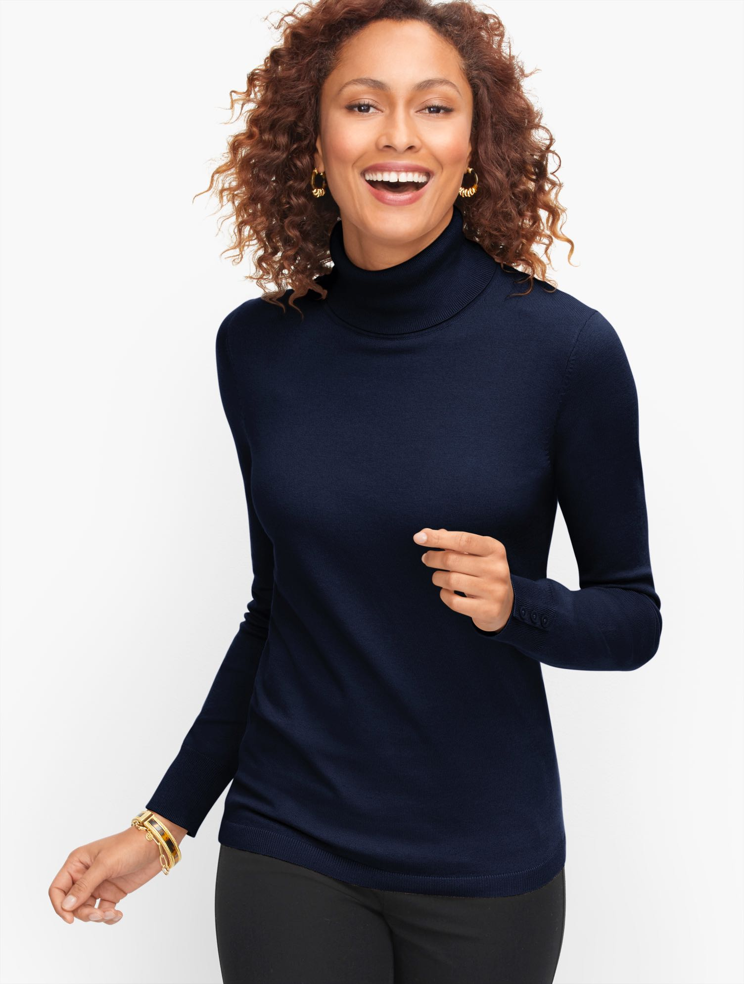 Your favorite turtleneck sweater returns. In a fresh assortment of colors to add to your collection. (There\\\'s no such thing as too many.) Features Sleeve length: LongNeckline: TurtleHits: At hipClosure: PulloverImported Fit: Misses: 25 1/2 inches; Petite: 24 1/2 inches; Plus: 27 inches Material: 58% Cotton, 23% Modal, 16% Nylon, 3% Lycra Care: Machine Wash; Reshape, lay flat to dry Perfect Turtleneck Sweater - Blue - 3X Talbots