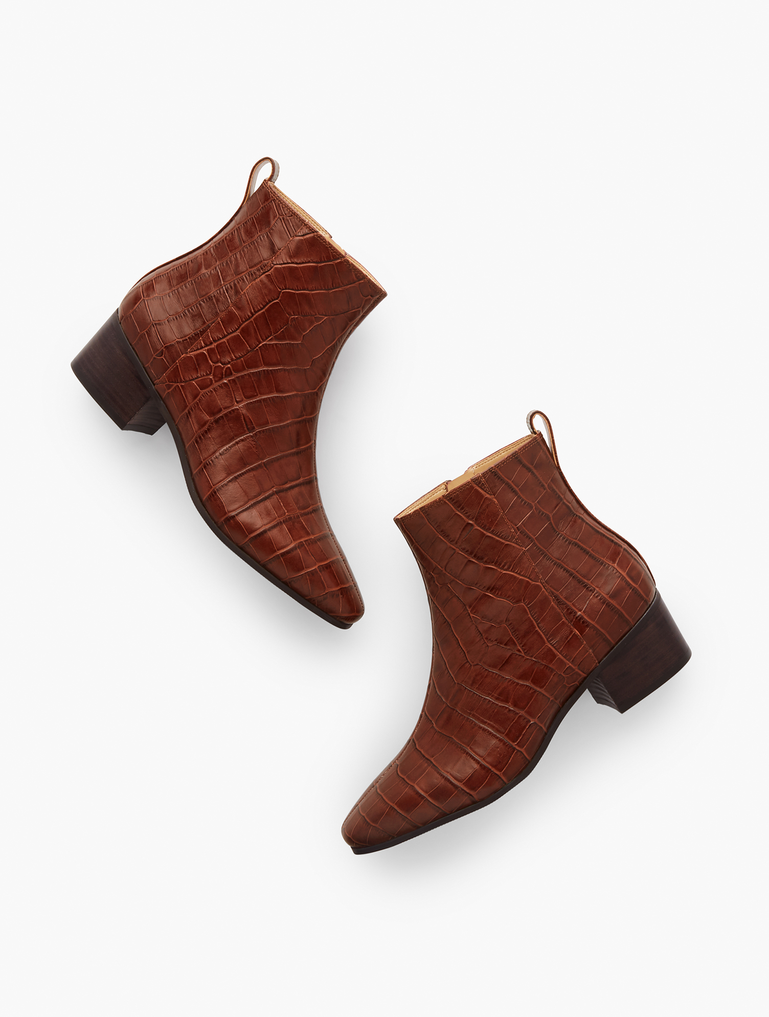 Your favorite Dakota ankle boots are back. In embossed croc. With block heel and inside zip. Features Gift Box/Gift Wrap is not available for this item Inside side zip 1 3/4 inches heel Almond toe 3MM Memory Foam Footbed Imported Material: 100% Leather Dakota Ankle Boots - Embossed Croc - Amber Rust - 11M Talbots