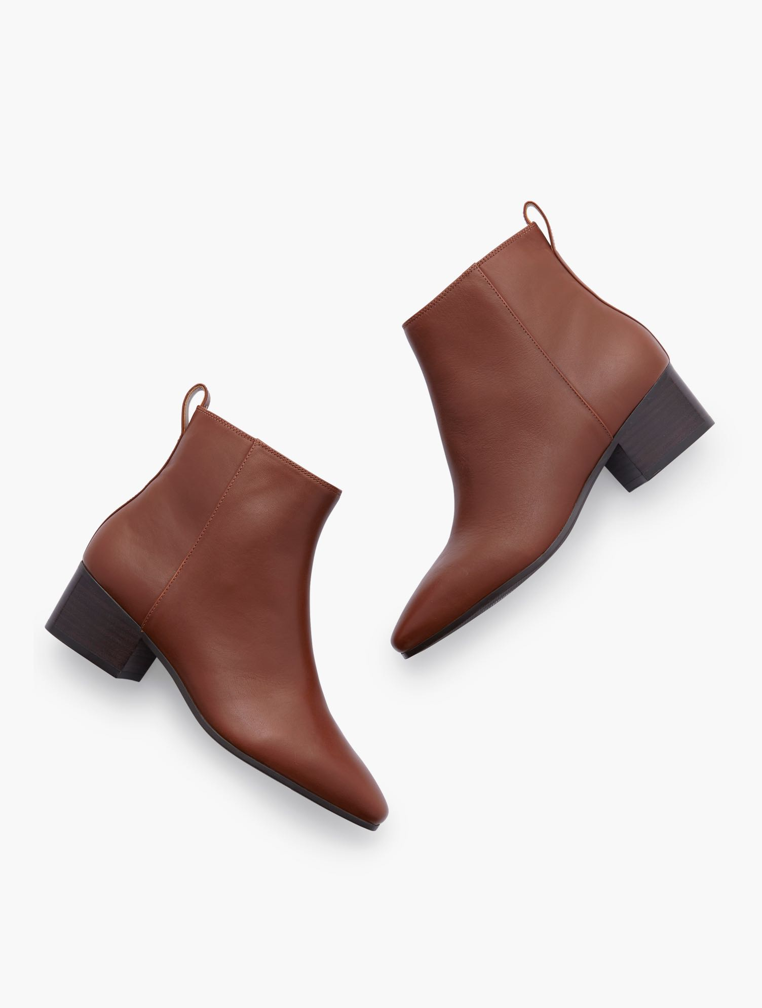 Your favorite Dakota ankle boots are back. In rich leather. With block heel and inside zip. Features Gift Box/Gift Wrap is not available for this item Inside side zipper 1 3/4 inches heel Almond toe 3MM Memory Foam Footbed Imported Material: 100% Leather Dakota Ankle Boots - Leather - Dark Rum - 11M Talbots