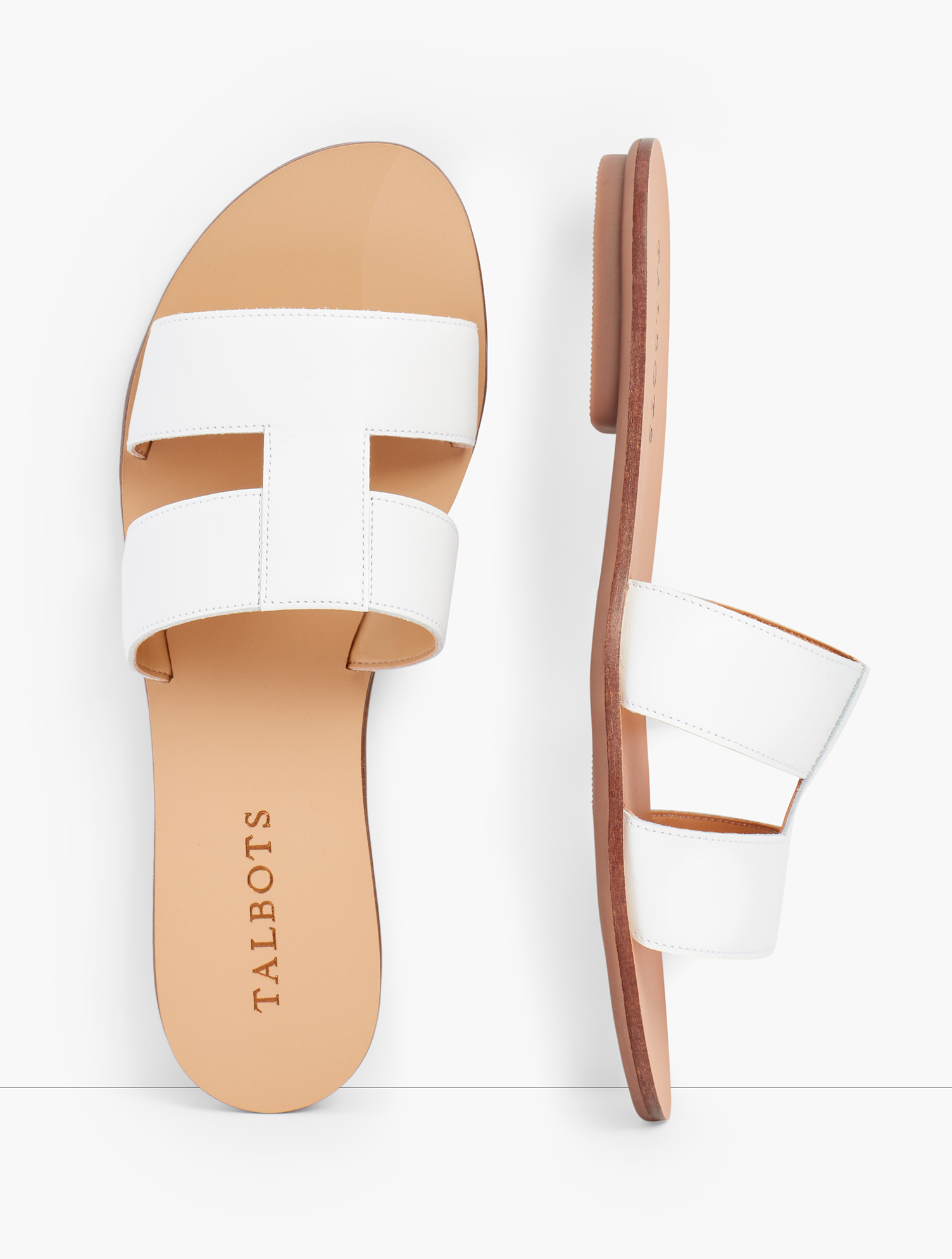 Luxe Vachetta leather slides. With geometric flair. A chic and easy go-to any day of the week. Features Gift Box/Gift Wrap is not available for this item 1/3 inches heel Rubber Sole Imported Material: 100% Leather Hannah Vachetta Leather Slides - White - 11M Talbots