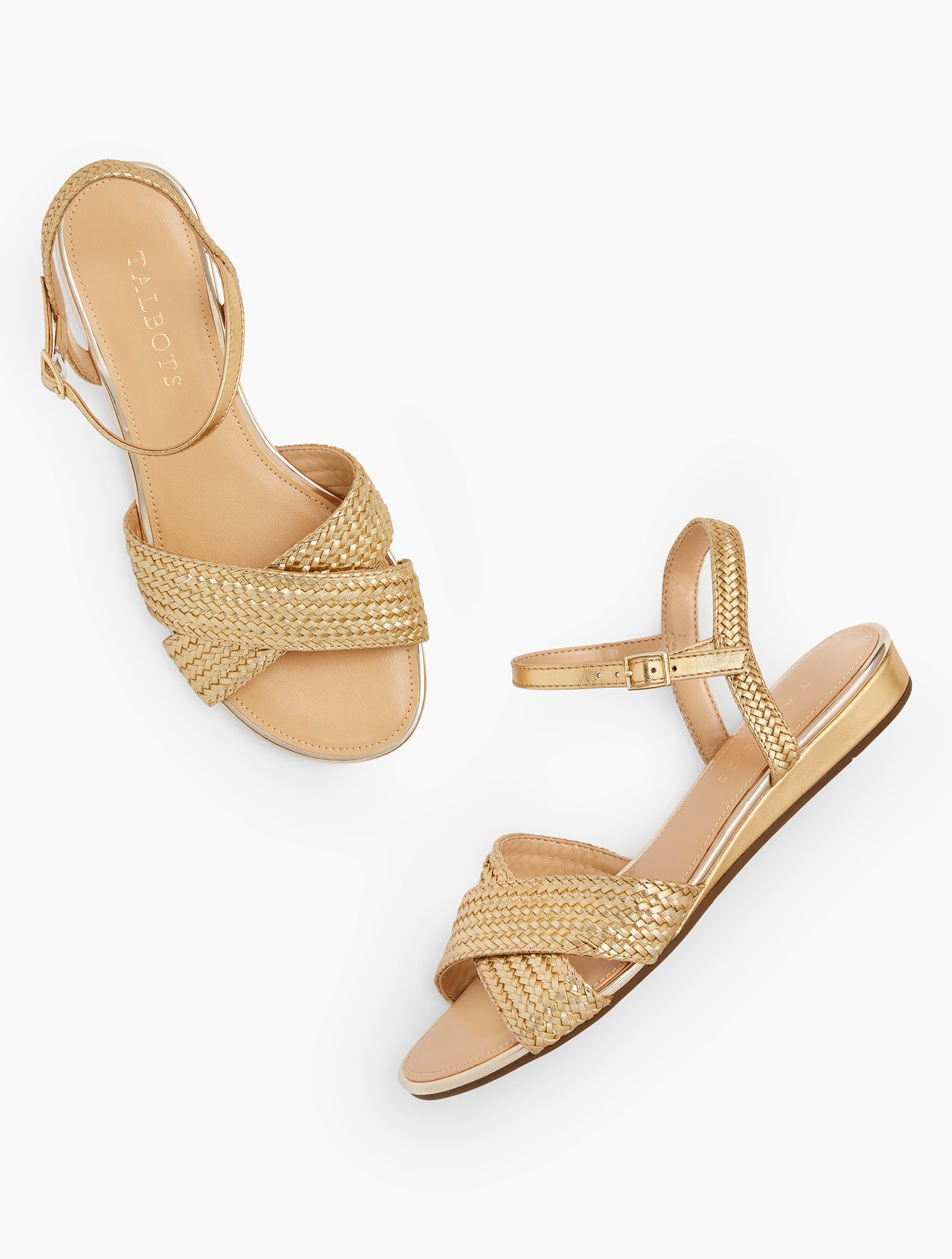 The Daisy. Our modern micro-wedge gives you just the lift you need. Classic and comfortable. In rich gold. Features Gift Box/Gift Wrap is not available for this item 3/4 inches Heel Round toe 3MM Memory foam footbed Gold hardware Imported Material: 100% Polyurethane Daisy Micro Wedge Sandals - Metallic - Rich Gold - 11M Talbots