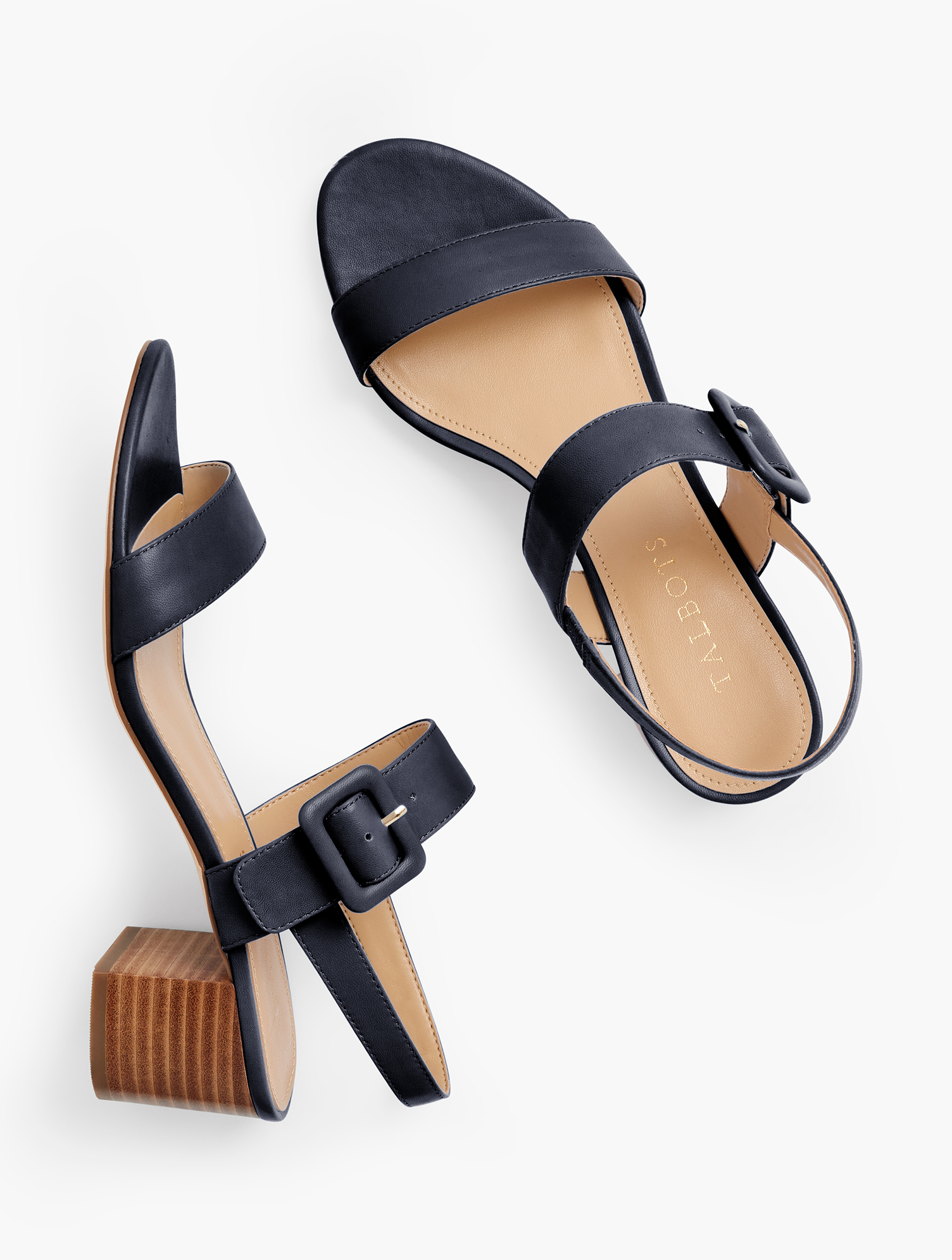 Our chic Mimi block-heel sandals. With fashionable, buckle closure. Crafted from soft Nappa leather for comfort and luxury. Features Gift Box/Gift Wrap is not available for this item 2 inches heel Flexible Non Skid Sole 3Mm Memory Foam Footbed Imported Material: 100% Leather Mimi Leather Block Heel Sandals - Indigo - 5M Talbots